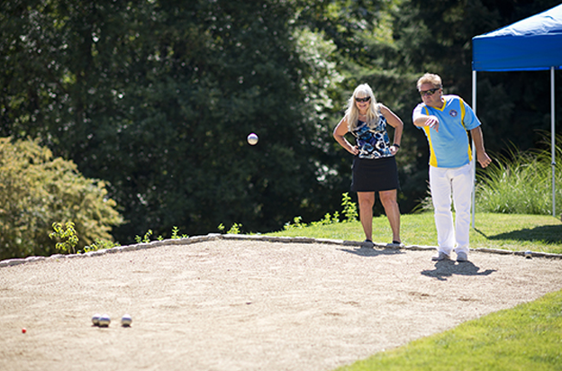 Couple playing petanque at WillaKenzie Estate